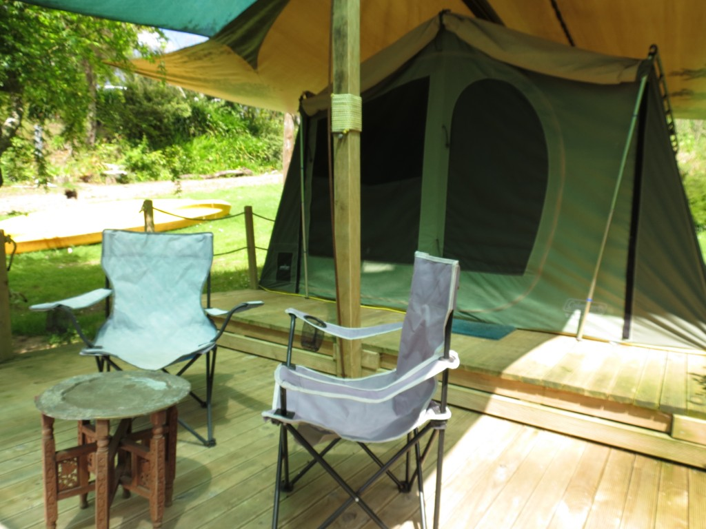 Sit on the deck of a Safari Tent