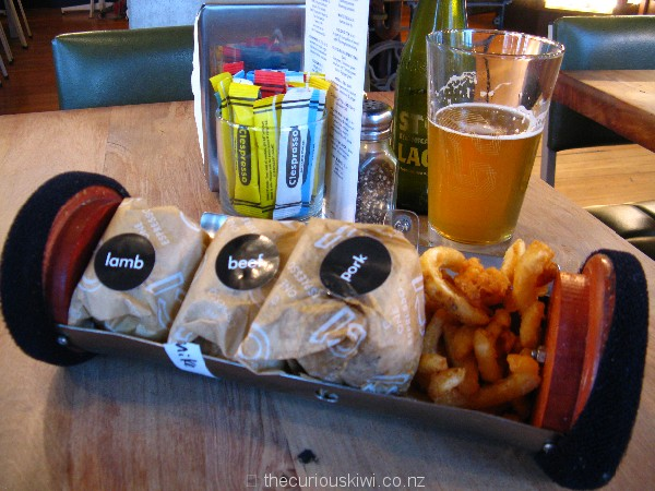 Open cannister containing 3 sliders and curly fries - $20 at C1 Espresso