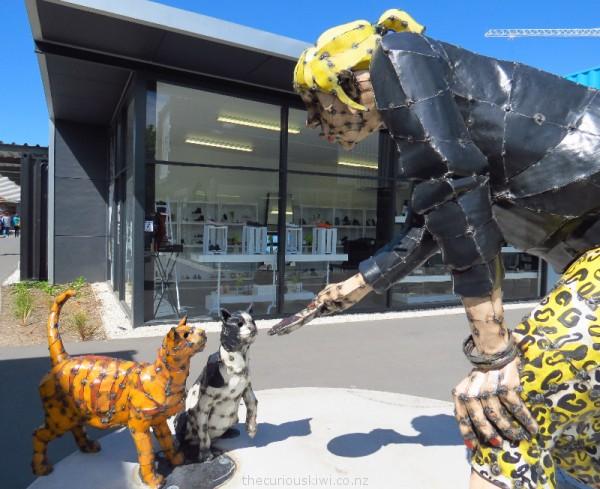 Tanya Brown feeding cats at Re:START by sculptor Hannah Kidd