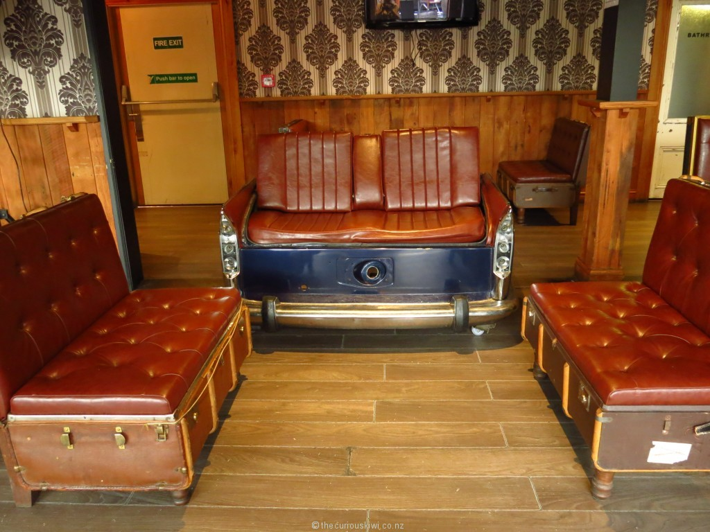 Back end of a Morris Oxford, and suitcase seating