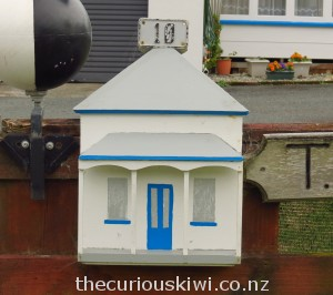 Blue trimmed house replica