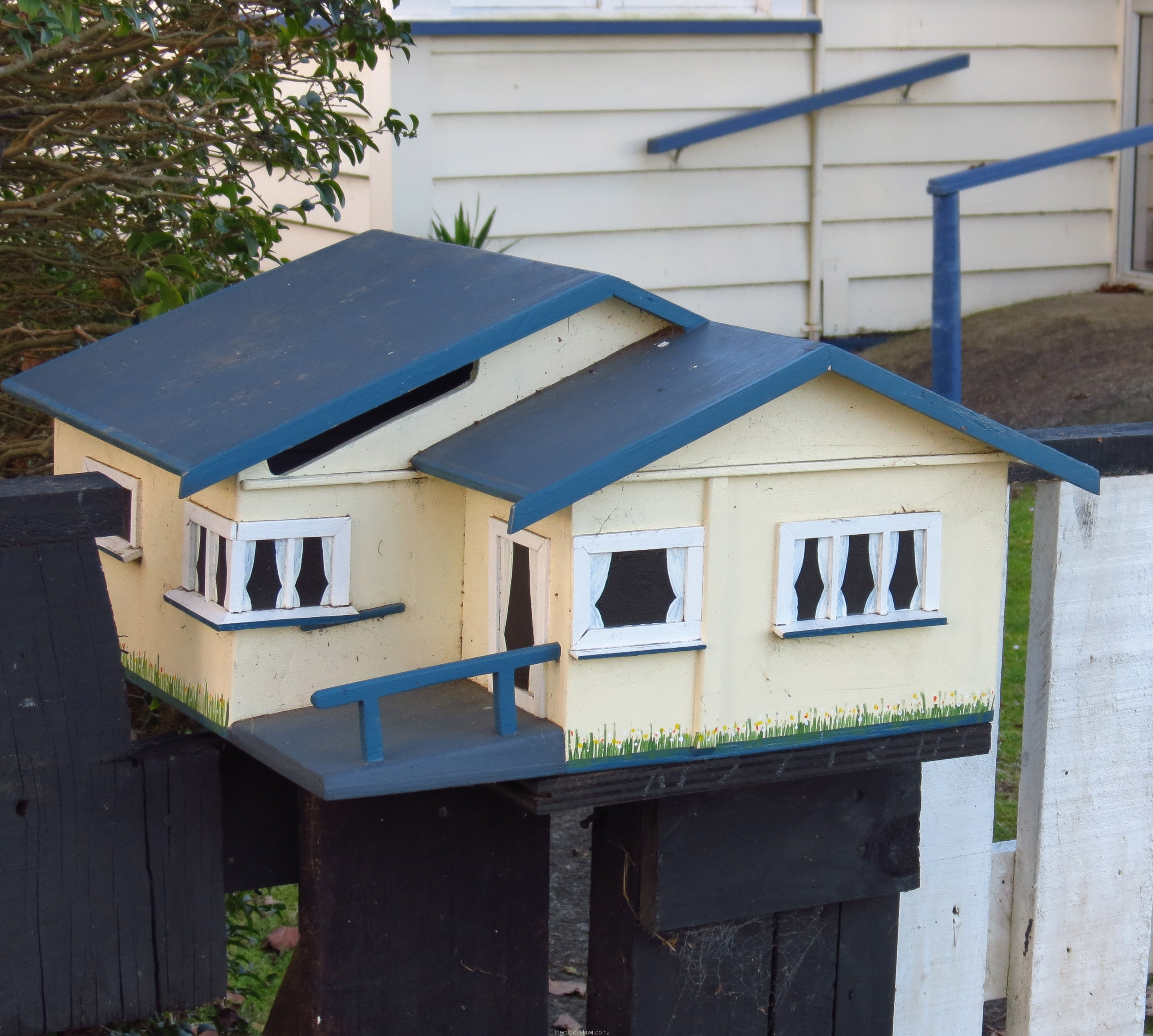 Neat letter box replica of a house near the beach