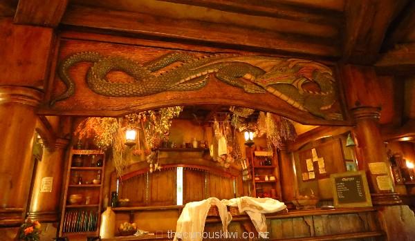 The carved green dragon above the food service area