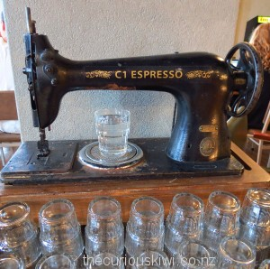 Singer sewing machine dispenses water at C1
