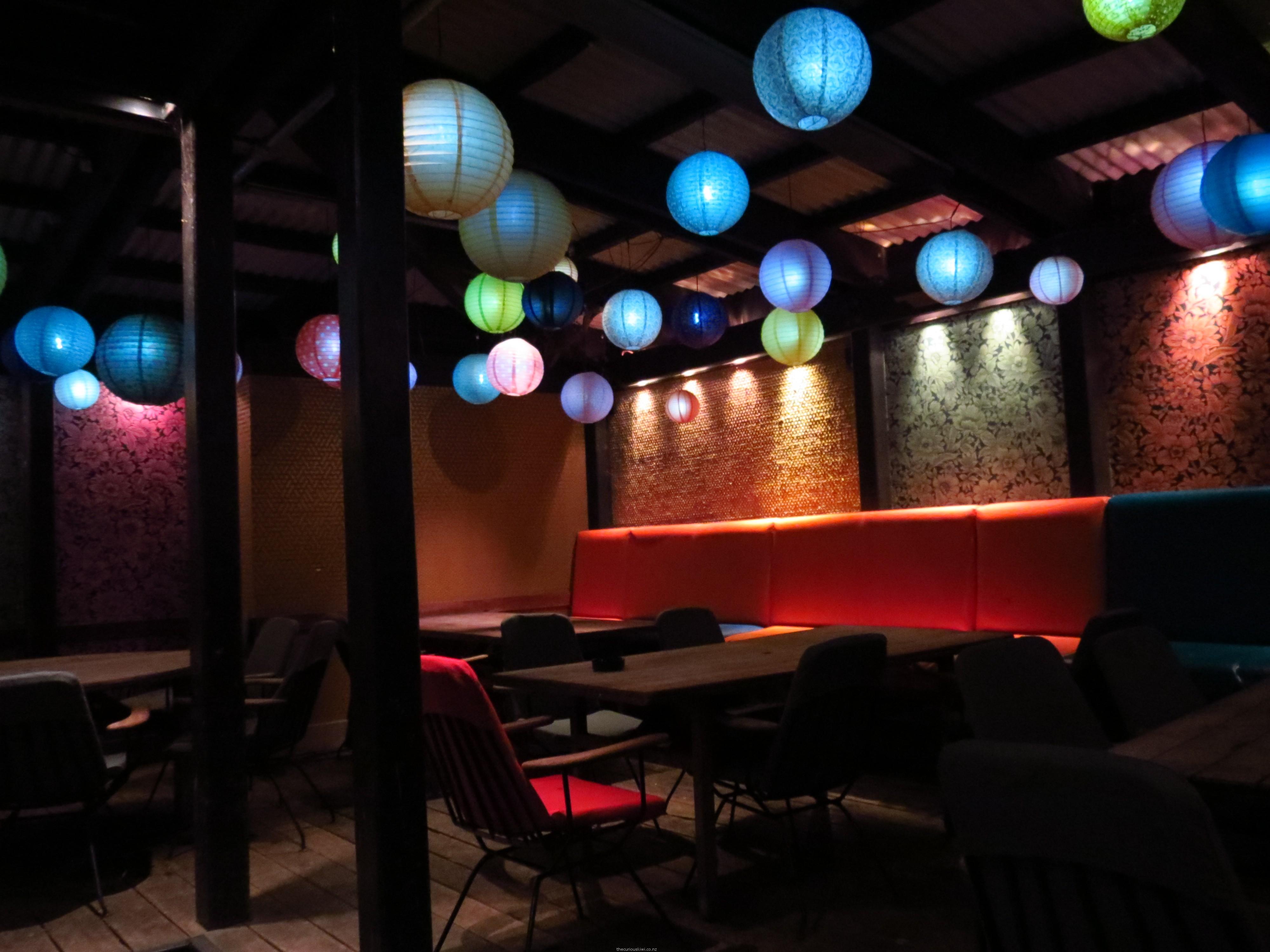 Sit under the lanterns in the garden bar