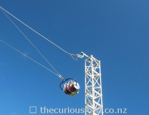 Pull the cord, the Skyswing is released and you swing over the side of the mountain