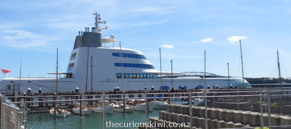 $350 million super duper superyacht - 119 metres long with 3 swimming pools and a room with walls covered with sting ray hides. The superyacht dwarfed the Auckland Harbour Bridge in 2013.