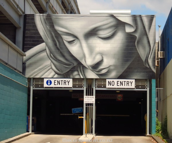 The face of Mary from the Pieta sculpture, Elizabeth Street car park building