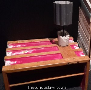 Coffee table, and concrete and corrugated iron lamp  on display at Canterbury Museum