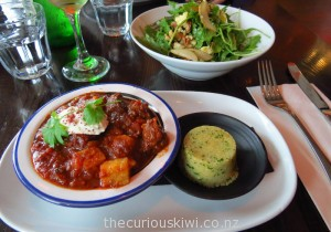Moroccan lamb tagine & Rocket, pear & blue cheese salad