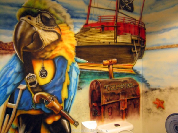 Pirate themed art work on the toilet walls at The Jolly Roger