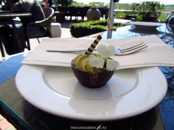 Aromatic tea mousse in a chocolate cup decorated with an edible flower