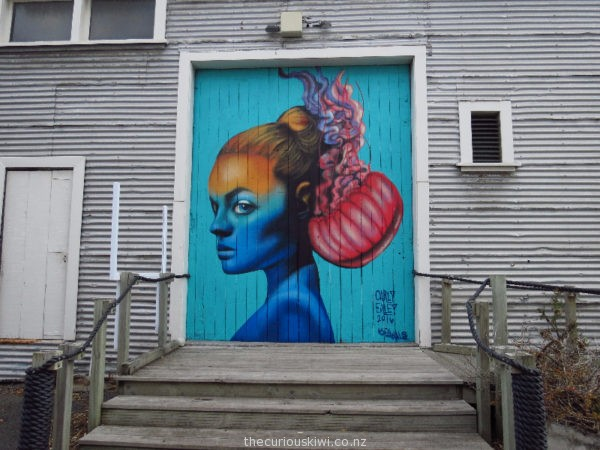 'Dangerous Balance by Carly Ealey' (there are two more murals alongside this one)